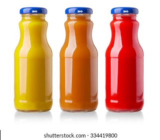 different bottles of juice on white background