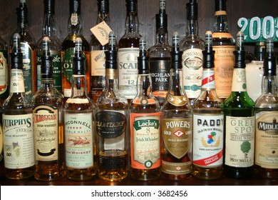 a lot of different bottles of whiskey