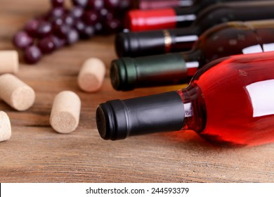 Different bottles of wine on table close-up