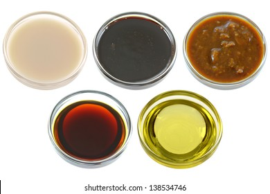 Different Bowls of Soybean (Soya beans) Products - Soy Milk, Dark Soy Sauce, Salted Fermented Soya Beans, Light Soy Sauce, and Soybean oil  isolated on white background