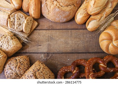 different breads on wood background