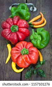 different breeds of peppers on wooden vintage surface