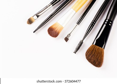 Different brushes for make up are on white background.