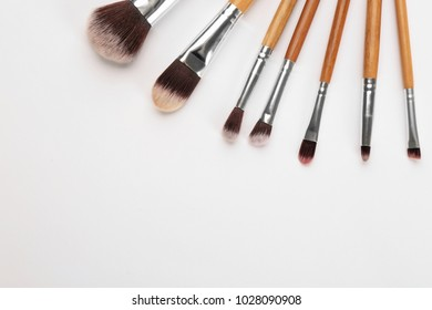 Different brushes of professional makeup artist on white background