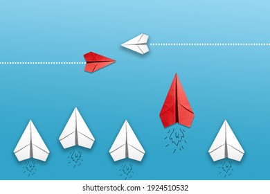 Different business concept.Red paper plane changing direction from white paper plane.