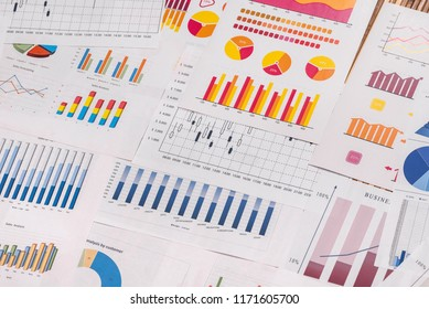 Different business graphs and diagrams used as background