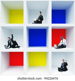 different businesspeople sit in 3d box