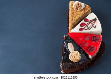 different cakes with nuts on black background