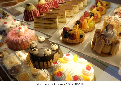 different cakes on display in the  bakery window