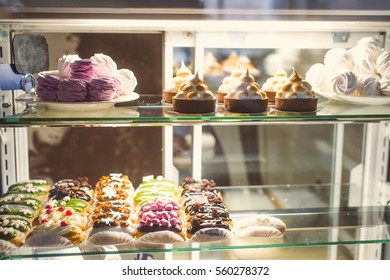 Different cakes on display in the cafe