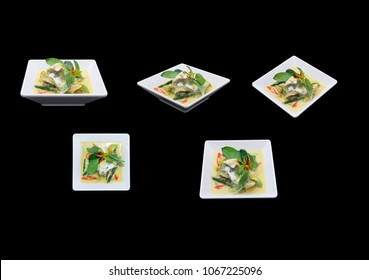 Different camera view Thai Green Curry Fish. isolated on black.