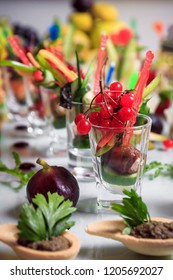 Different canapes with smoked salmon, cucumber cherry tomatoes served on a table