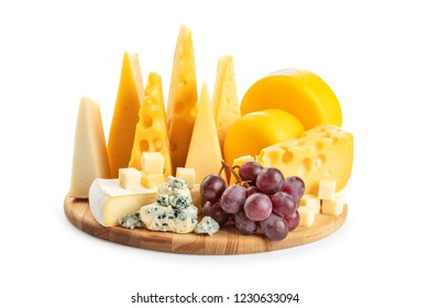 Different cheese and grapes on a board isolated on white background