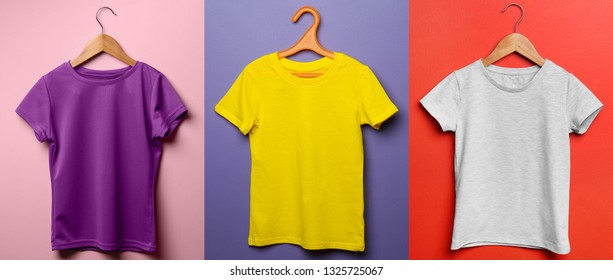 Different child t-shirts on color background