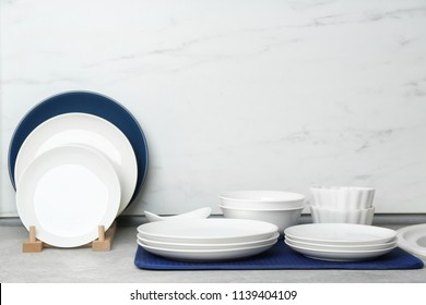 Different clean plates on counter in kitchen