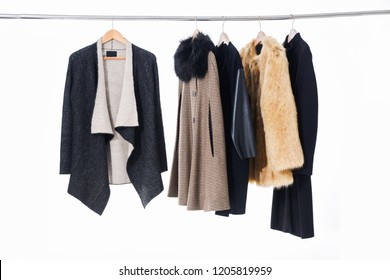 different clothes ,fur coat for females on hanging
