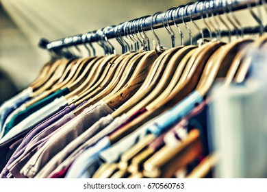 Different clothes on hangers in the store