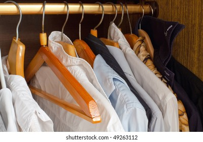 different clothes with one hanger empty