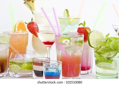 different cocktails and drinks on white background
