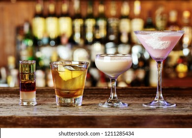 different cocktails on the bar, cocktails from different alcoholic drinks in glasses of different shapes, space for text