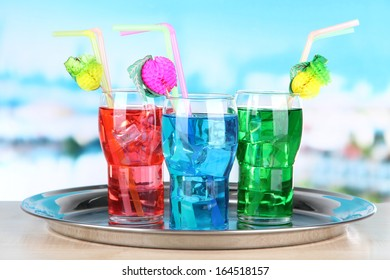 Different cocktails on bright background