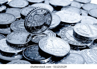Different coins in a different order on a light background.