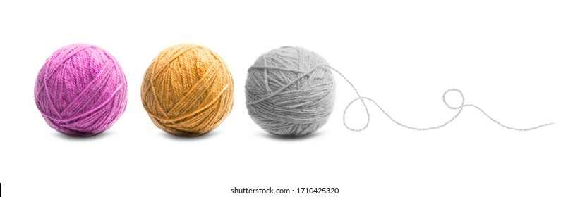 Different color balls of threads wool yarn isolated on white background