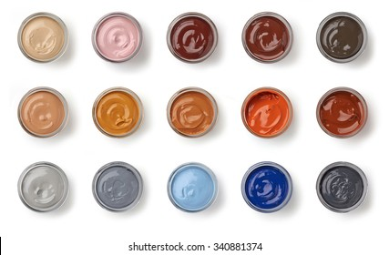 different color shoe grease jars isolated on white background