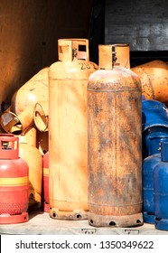 Different color and size cylinder gas bottles stored in a delivery van for refill and supply