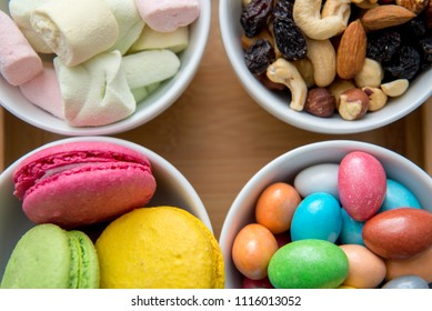 Different color sweets on bowl.