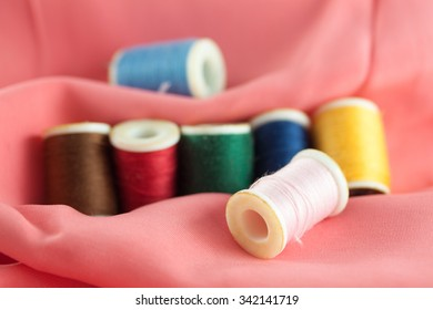 Different color of thread on fabric, fashion design concept