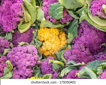 Different color varieties of cauliflower for sale at local farmers market.