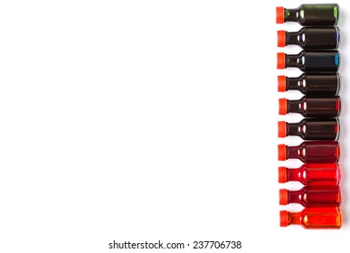 Different color variety of liquid food color additives over white background