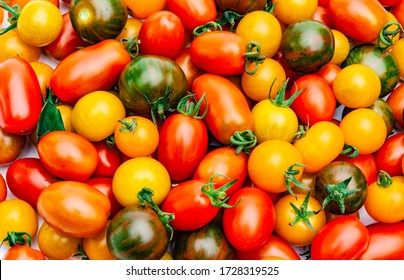 Different colored cherry tomatoes from fresh harvest