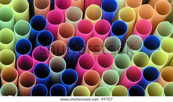 different colored drinking straws stacked together
