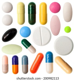 Different colored medicine and types of pills isolated on a white background.