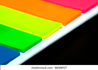 Different colored notes with a black background