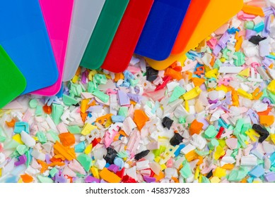 different colored recycled plastic parts with color samples selected focus, narrow depth of field