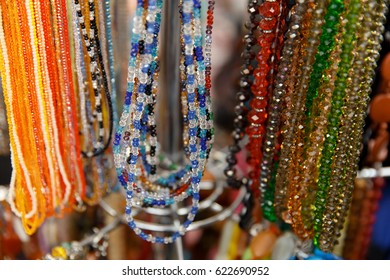 different colorful handmade beads at african flea market.