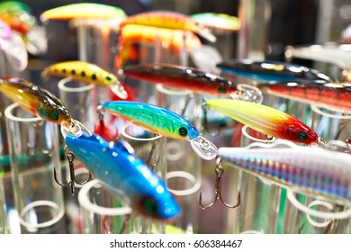 Different colorful plastic fishing baits in store