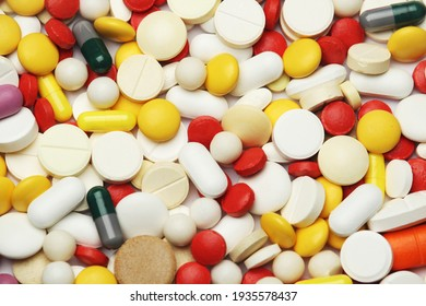 Different colorful tablets at white background