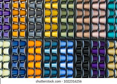 Different colors aluminium coffee capsule. Luxury premium background for the store with coffee capsule.