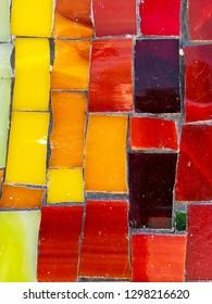Different colors of ceramic mosaic tiles. Close up shot.