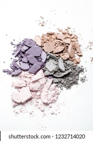 Different colors of crushed eye shadows on white background.