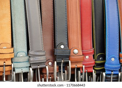 different colors leather belt on display at the market for sale