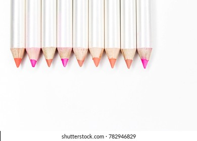 Different colors of lip liner on white background