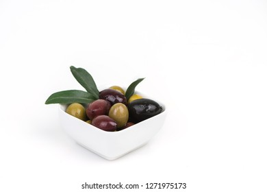 Different colors olives in a white background.
