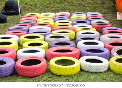 Different colors of painted car tires on children playground