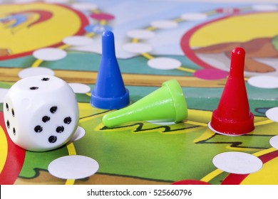 Different colors of Plastic chips with dice and Board game children.