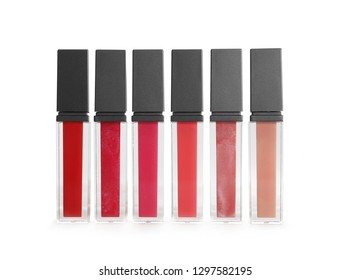 Different colour lipsticks on white background. Cosmetic product